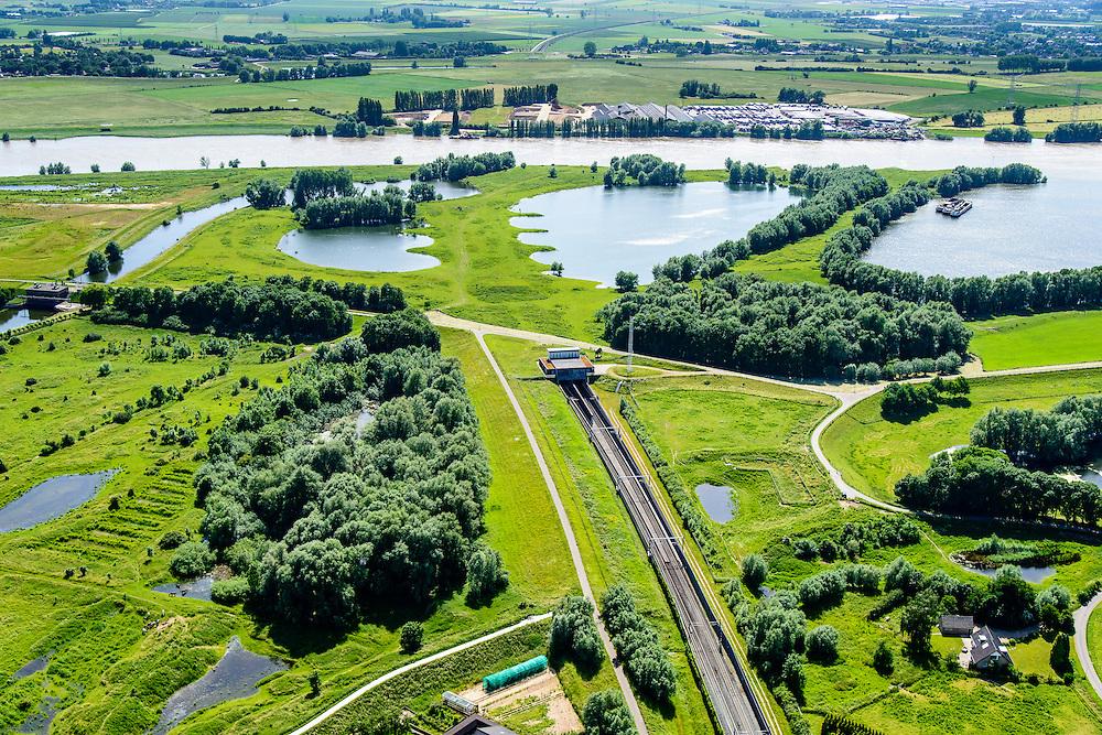 Nederland, Gelderland, Duiven, 09-06-2016; Groessen, natuurgebied Kandia. Betuweroute met dienstgebouw van de tunnel onder het Pannerdensch kanaal, in westelijke richting, Neder-Rijn in de achtergrond.<br /> Tunnel Betuweroute, freight railway, Pannerdensch channel (Lower Rhine) on the horizon.<br /> luchtfoto (toeslag op standard tarieven);<br /> aerial photo (additional fee required);<br /> copyright foto/photo Siebe Swart