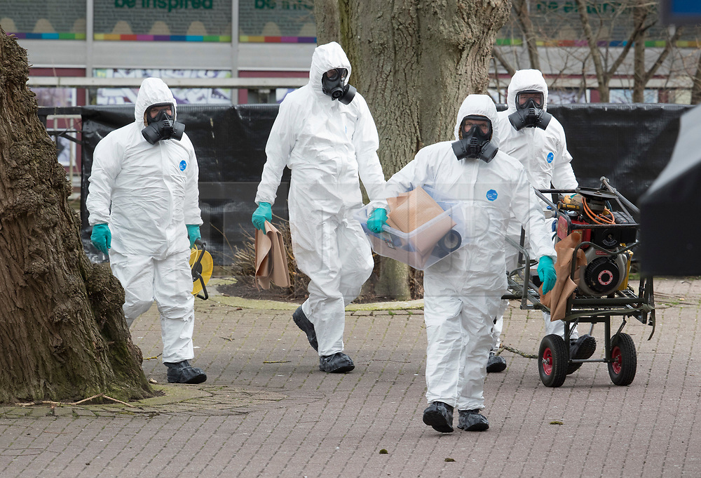 © Licensed to London News Pictures. 23/03/2018. Salisbury, UK. Military personnel in protective suits and gas masks prepare to remove the bench where former Russian spy Sergei Skripal and his daughter Yulia were poisoned with nerve agent in Salisbury. The couple where found unconscious the bench in Salisbury shopping centre on 4th March 2018. Photo credit: Peter Macdiarmid/LNP