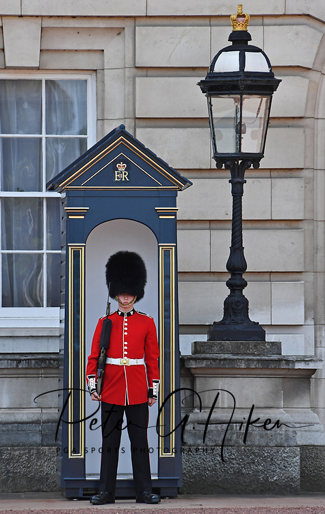 A Royal Guard stands his post at Buckingham Palace in London, England.