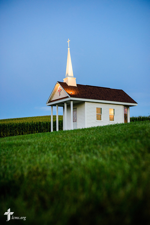 The Wayside Prayer Chapel is illuminated in the evening sky on Saturday, July 18 2015, at Mission Central in Mapleton, Iowa. LCMS Communications/Erik M. Lunsford