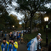 November 1, 2015 - New York, NY : Runners exit Central Park at West 81st Street, after completing the 2015 TCS New York City marathon on Sunday.<br />  CREDIT: Karsten Moran for The New York TImes