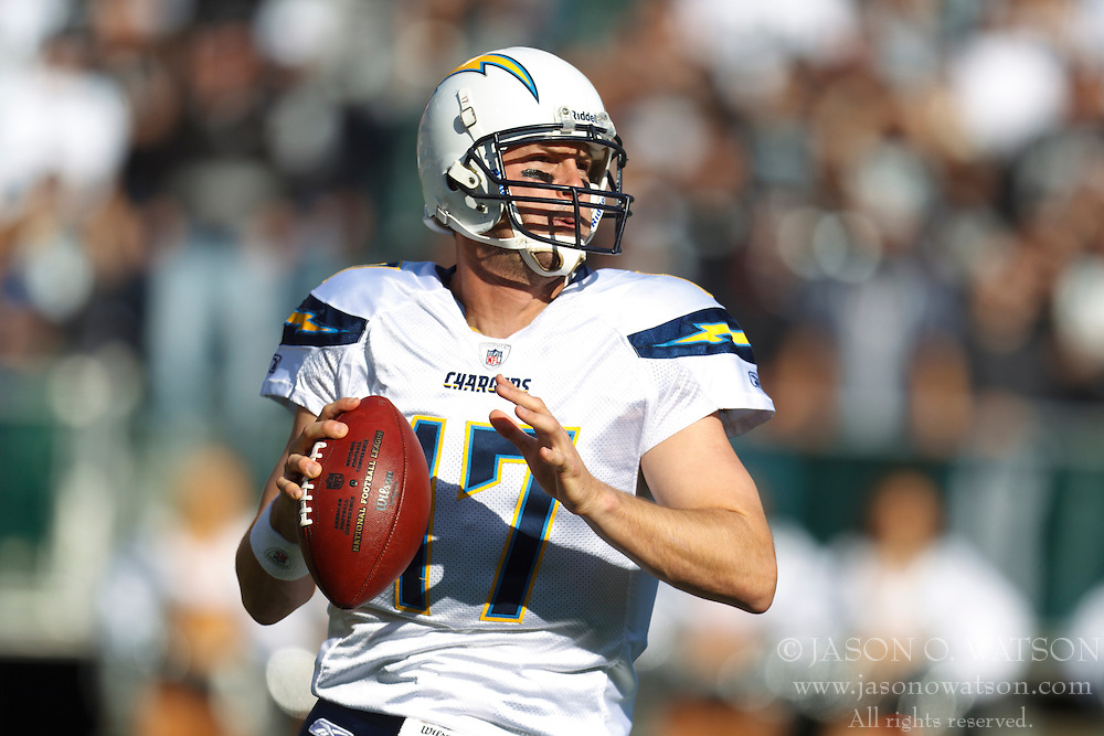 Jan 1, 2012; Oakland, CA, USA; San Diego Chargers quarterback Philip Rivers (17) stands in the pocket against the Oakland Raiders during the first quarter at O.co Coliseum. San Diego defeated Oakland 38-26. Mandatory Credit: Jason O. Watson-US PRESSWIRE