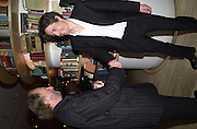 Ed Victor and Hugh Grant.Talk pre-Bafta party. St. Martin's Lane Hotel. London. 24 February 2001. © Copyright Photograph by Dafydd Jones 66 Stockwell Park Rd. London SW9 0DA Tel 020 7733 0108 www.dafjones.com