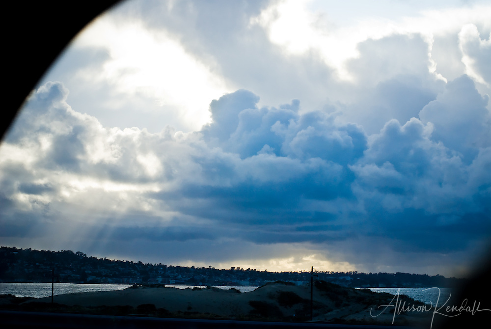 A spring storm casts rain and sunrays over the Monterey Bay and Peninsula