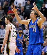 Dallas Mavericks power forward Dirk Nowitzki (41) of Germany reacts after scoring a three-pointer to tie the game in overtime as Utah Jazz shooting guard Gordon Hayward (20) walks past during an NBA basketball game, Monday, April 16, 2012, in Salt Lake City. The Jazz defeated the Mavericks in triple overtime, 123-121. Nowitzki scored 40-poins in the game. (AP Photo/Colin E Braley).