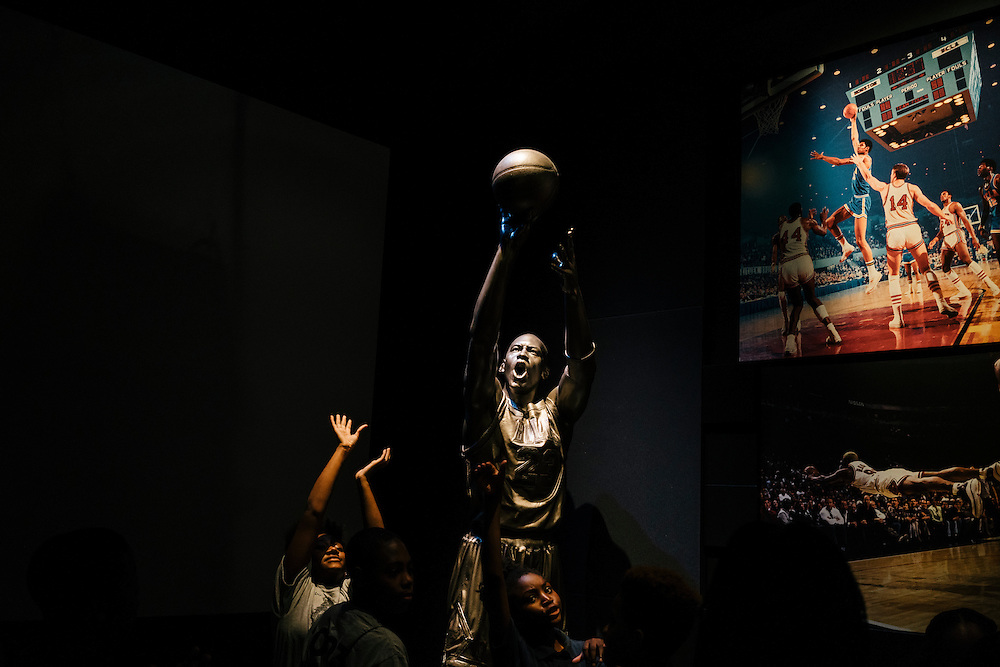 Sixth-graders from Knowledge Is Power Program (KIPP) DC, pose next to a statue of Michael Jordan inside the Smithsonian National Musuem of African American History and Culture during their visit on Oct 21, 2016. The students spent an hour touring the new Washington, D.C. museum, which is only available to see with reserved tickets during the first year.