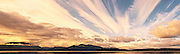 Evening alpenglo colored clouds cross the sky in a panorama of the Hood Canal and Toandos Peninsula as viewed from the Kitsap Peninsula in Puget Sound, Washington, USA. panorama