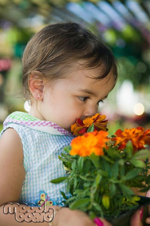 Girl Smelling Marigolds
