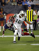 New York Jets special teams return man Brad Smith (16) dodges tackles as he returns a kick during the NFL football game against the Buffalo Bills, December 3, 2009 in Toronto, Canada. The Jets won the game 19-13. ©Paul Anthony Spinelli