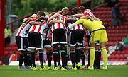 Brentford trying to psyche themselves up during the Sky Bet Championship match between Brentford and Reading at Griffin Park, London, England on 29 August 2015. Photo by Matthew Redman.