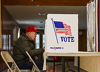 Dave Spooner sits at the voting booth at Leavitt Park Clubhouse to cast his vote during the NH Primary.  (Karen Bobotas/for the Laconia Daily Sun)