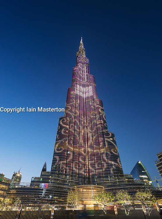 Dusk view of Burj Khalifa tower with LED patterns on facade in Dubai United Arab Emirates