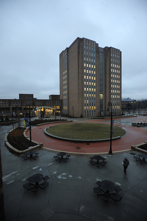 A student walks through the Risman Plaza on a winter day. The newly renovated plaza is the central hub of Kent State life.