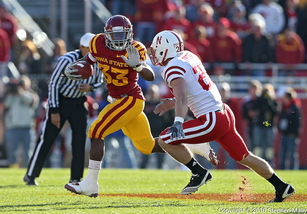 November 06 2010: Iowa State Cyclones running back Alexander Robinson (33) tries to hold off Nebraska Cornhuskers defensive back Lance Thorell (23) on a run during the first half of the NCAA football game between the Nebraska Cornhuskers and the Iowa State Cyclones at Jack Trice Stadium in Ames, Iowa on Saturday November 6, 2010. Nebraska defeated Iowa State 31-30.