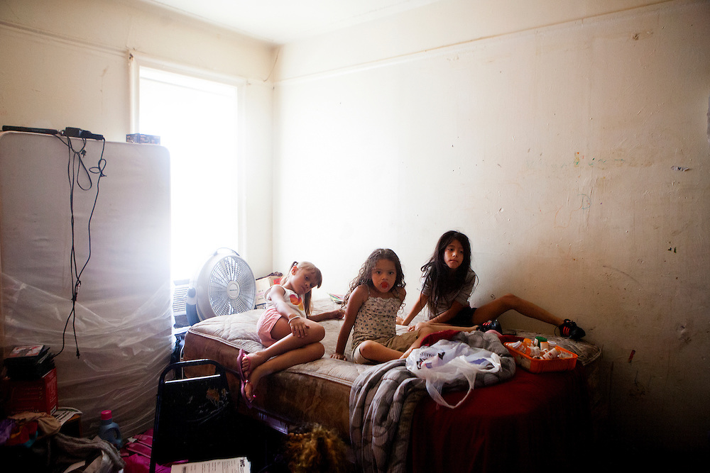 BROOKLYN, N.Y. - AUGUST 28, 2015: Merlinda Fernandez' children Destiny Miranda (center) and Carmen Miranda (right) with a friend at their apartment at 60 Clarkson Avenue. Residents, many of whom have been asked to leave the building, have complained of mold and roach and mice infestations, among other problems in the building. CREDIT: Sam Hodgson for The New York Times