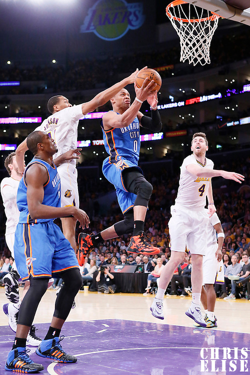 09 March 2014: Oklahoma City Thunder point guard Russell Westbrook (0) goes for the layup during the Los Angeles Lakers 114-110 victory over the Oklahoma City Thunder at the Staples Center, Los Angeles, California, USA.