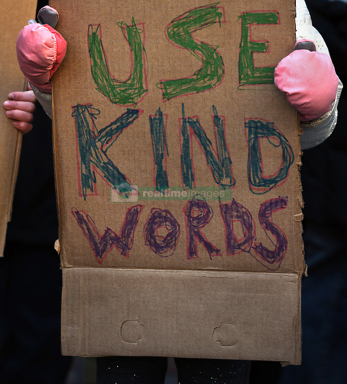 """December 10, 2016 - Washington, DC, USA - ELSIE KARLINS, 5 years old (far right) holds a sign saying ''Use Kind Words'' as the group stand in front of hotel. Children's Rally for Kindness takes place at Trump International Hotel in Washington DC on December 10, 2016 organized by the Takoma Parents Action Coalition.  According to their FaceBook page, it was a call to President-elect Donald Trump: ''to remember these lessons as he prepares to take office and implement policies that will affect the lives of children and families across our diverse nation.''.''All over the world, across cultures and countries, children learn the same basic lessons: .Ã'be kind,Ã"""" .Ã'tell the truth,Ã"""" .Ã'be fair,Ã"""" .Ã'respect everyone,Ã"""" .Ã'treat others the way you want to be treated,Ã"""" .Ã'donÃ•t touch others if they donÃ•t want to be touched. (Credit Image: © Carol Guzy via ZUMA Wire)"""