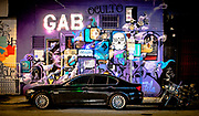 Nighttime street scene in Miami's Wynwood Arts Ditrict somehow resembles a stage set.