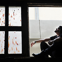 Nueva Trova singer Carlos Varela sits in a window at his rehearsal space in Havana, Cuba, Friday,  April 30, 2010.