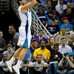 January 24,  2011; New Orleans, LA, USA; New Orleans Hornets shooting guard Marco Belinelli (8) shoots against the Oklahoma City Thunder during the second half at the New Orleans Arena. The Hornets defeated the Thunder 91-89. Mandatory Credit: Derick E. Hingle