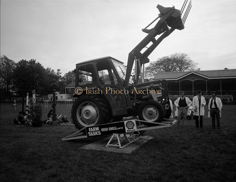 National Farm Tasks Competition Final  (K25).1976..07.05.1976..05.07.1976..7th May 1976..The final of the National Farm Tasks Competition were held in the R.D.S.(Royal Dublin Showgrounds, Dublin) The competition was sponsored by Irish Shell Ltd. Over 400 teams originally took part in the competition. The overall winners were the Tullyallen,Co Louth branch of Macra na Ferime..Picture shows a member of The Tullyallen team doing a tractor skills test under the watchful eyes of the four judges..