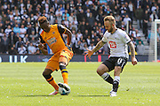 Hull midfielder Moses Odubajo and Derby forward Johnny Russell challenge for the ball during the Sky Bet Championship play-off first leg match between Derby County and Hull City at the iPro Stadium, Derby, England on 14 May 2016. Photo by Aaron  Lupton.