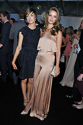 Left to right, JO ELVIN and ROSIE HUNTINGTON-WHITELEY at the Glamour Women of The Year Awards 2011 held in Berkeley Square, London W1 on 7th June 2011.