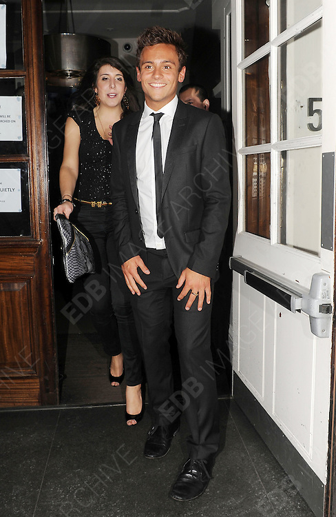 25.OCTOBER.2012. LONDON<br /> <br /> TOM DALEY LEAVING FUNKY BUDDAH NIGHT CLUB IN MAYFAIR WITH A GROUP OF GIRLS.<br /> <br /> BYLINE: EDBIMAGEARCHIVE.CO.UK<br /> <br /> *THIS IMAGE IS STRICTLY FOR UK NEWSPAPERS AND MAGAZINES ONLY*<br /> *FOR WORLD WIDE SALES AND WEB USE PLEASE CONTACT EDBIMAGEARCHIVE - 0208 954 5968*