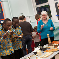 Picture Shows : Teachers Ayakwa Kwabena, Patrick Asiedu of Juliet Johnson School, Ghana sample Scottish food as Muthill Head Teacher Moria Brown and Willie Jones, Gleneagles' Food & Beverage Services Manager  look on..Muthill Primary School, Muthill by Crieff, Perthshire, Scotland stage an evening of international cooking to celebrate their joint work with a partner school Juliet Johnson School, Ghana which is visiting this week. They have strong links with the Ghanians and have helped to raise money to contribute toward funding a new school bus.   Feature for TESS..Picture Drew Farrell Tel : 07721-735041