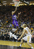 January 12 2010: Northwestern Wildcats guard JerShon Cobb (23) puts up a shot over Iowa Hawkeyes guard Matt Gatens (5) during the second half of an NCAA college basketball game at Carver-Hawkeye Arena in Iowa City, Iowa on January 12, 2010. Northwestern defeated Iowa 90-71.