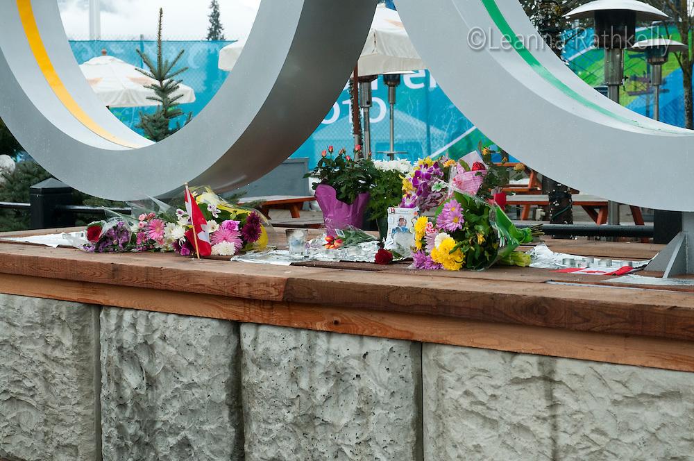 Flowers, photos and memorabilia are left to commemorate Georgian luger Nodar Kumaritashvili.
