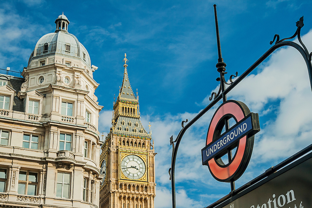 An iconic London underground sign in front of Big Ben at Westminster. Westminster is a famous tourist hot-spot, famous for Big Ben and The Houses of Parliament. It is operated by London Underground's Jubilee and District Lines.