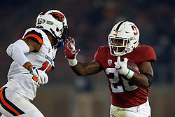 PALO ALTO, CA - NOVEMBER 10: Running back Dorian Maddox #28 of the Stanford Cardinal rushes up field towards safety Jeffrey Manning Jr. #15 of the Oregon State Beavers during the third quarter at Stanford Stadium on November 10, 2018 in Palo Alto, California. The Stanford Cardinal defeated the Oregon State Beavers 48-17. (Photo by Jason O. Watson/Getty Images) *** Local Caption *** Dorian Maddox; Jeffrey Manning Jr.