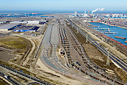 Nederland, Zuid-Holland, Rotterdam, 18-02-2015; Euopaweg buigt af naar de Maasvlakte, Slufter en Tweede Maasvlakte (MV2) in het verschiet. Rechts Emplacement Maasvlakte, Distripark en watere van de Hartelhaven. Infrabundel van autosnelweg N15, spoorweg (Betuweroute) en hoogspanningsleidingen. <br /> New and man-made land in the North sea <br /> designate for the Port of Rotterdam. Infrastructure bundle: motorway, railway (Betuweroute) and power lines.<br /> luchtfoto (toeslag op standard tarieven);<br /> aerial photo (additional fee required);<br /> copyright foto/photo Siebe Swart