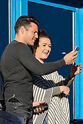 A fan has a selfie with Mark Wright during the EFL Sky Bet League 1 match between Gillingham and Peterborough United at the MEMS Priestfield Stadium, Gillingham, England on 25 March 2017. Photo by Martin Cole.