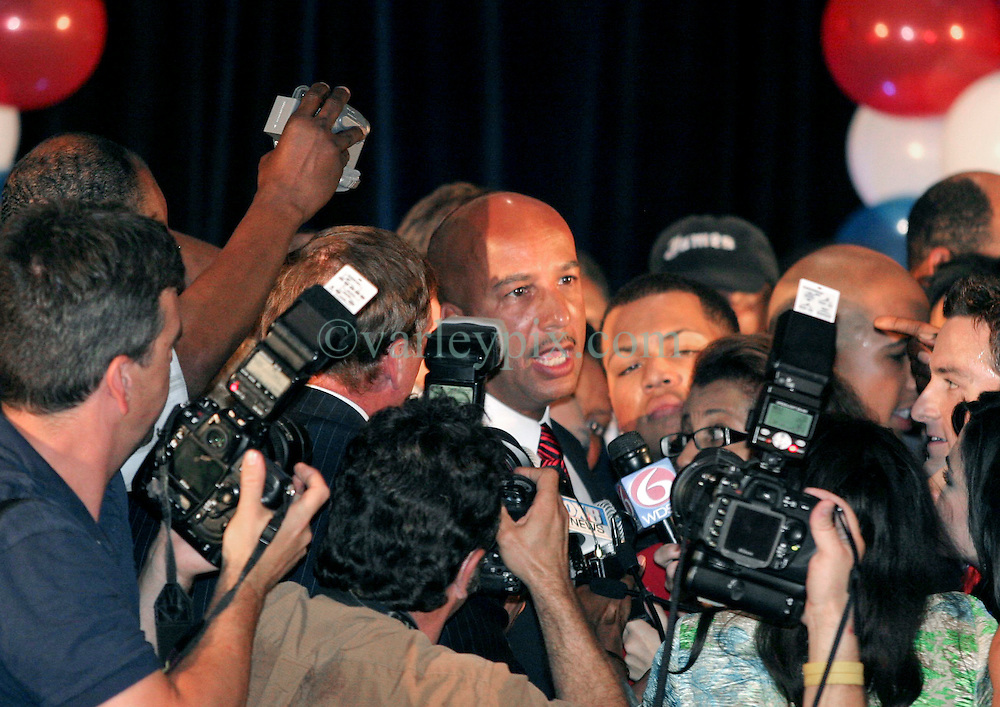 May 20th, 2006. New Orleans, Louisiana. Mayor Ray Nagin celebrates victory with his family and supporters at the Marriott Hotel in the race for Mayor of New Orleans as he is once again elected to office, beating off challenger Mitch Landrieu. Nagin's wife Seletha and 7 year old daughter Tianna are to his right.<br /> Photo; Charlie Varley/varleypix.com