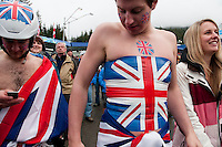 A fan from Britain created a british flag from tape on his body at the 4-man bobsleigh finals during the 2010 Olympic Winter Games in Whistler, BC Canada.