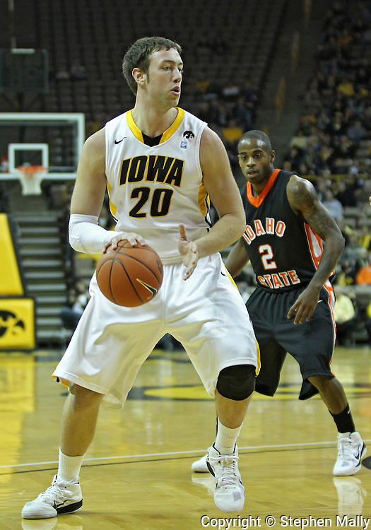 December 04 2010: Iowa Hawkeyes forward Andrew Brommer (20) drives with the ball during the first half of their NCAA basketball game at Carver-Hawkeye Arena in Iowa City, Iowa on December 4, 2010. Iowa won 70-53.