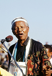 NELSON ROLIHLAHLA MANDELA (July 18, 1918 - December 5, 2013), 95, world renown civil rights activist and world leader. Mandela emerged from prison to become the first black President of South Africa in 1994. As a symbol of peacemaking, he won the 1993 Nobel Peace Prize. Joined his countries anti-apartheid movement in his 20s and then the ANC (African National Congress) in 1942. For next 20 years, he directed a campaign of peaceful, non-violent defiance against the South African government and its racist policies and for his efforts was incarcerated for 27 years. Remained strong and faithful to his cause, thru out his life, of a world of peace. Transforming the world, to make it a better place. PICTURED: South Africa 1994. Nelson Mandela speaks during part of his campaign tour, 1994