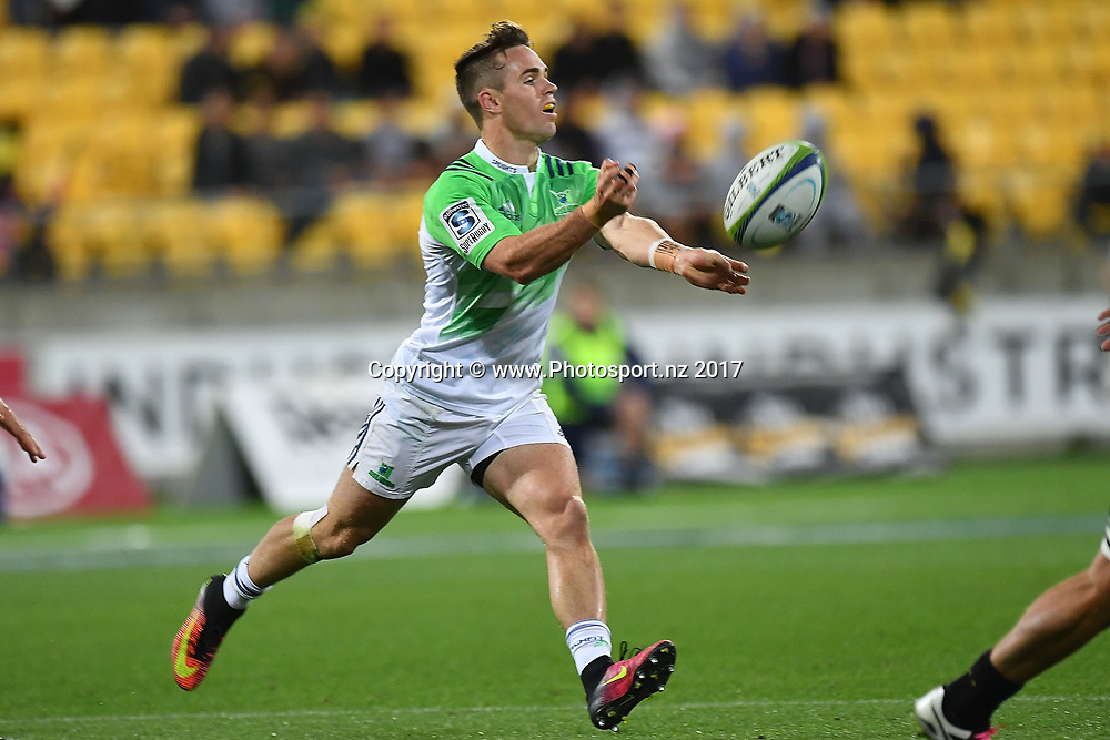 Highlanders' Fletcher Smith makes a pass during the Hurricanes vs Highlanders Super Rugby match at Westpac Stadium in Wellington on Saturday the 18th of March 2017. Copyright Photo by Marty Melville / www.Photosport.nz