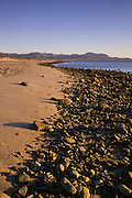 Morning light and rocks along the beach of Bahia de los Angeles at low tide, Baja California, Mexico