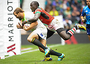 LONDON, ENGLAND - Sunday 11 May 2014, Frankie Horne of South Africa with a Kenyan on his back during the Plate final match between South Africa and Kenya at the Marriott London Sevens rugby tournament being held at Twickenham Rugby Stadium in London as part of the HSBC Sevens World Series.<br /> Photo by Roger Sedres/ImageSA