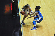 """Ole Miss' Maggie McFerrin (14) is forced out of bounds by Kentucky's Jennifer O'Neill (0) for a turnover at the C.M. """"Tad"""" Smith Coliseum in Oxford, Miss. on Thursday, February 28, 2013. Kentucky won 90-65."""