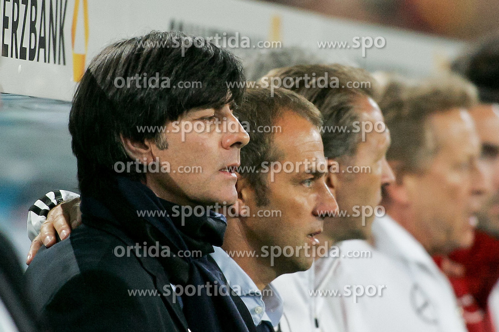 07.09.2010,  Rhein Energie Stadion, Koeln, GER, EM-Qualifikation, Deutschland vs. Aserbaidschan, im Bild: Joachim Loew (Trainer Deutschland)   re Hans-Dieter Flick ( Assistenz Trainer - GER )  EXPA Pictures © 2010, PhotoCredit: EXPA/ nph/  Mueller+++++ ATTENTION - OUT OF GER +++++ / SPORTIDA PHOTO AGENCY