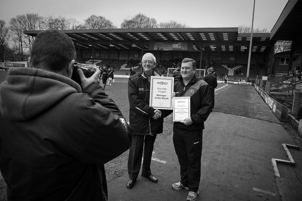 FC United of Manchester play a local team Chorley at Bury football club's ground in Lancashire, Britain. Photo shows club general manager, Andy Walsh (right), receiving an award before the game.