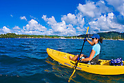 Woman kayaking on Hanalei Bay, Island of Kauai, Hawaii USA