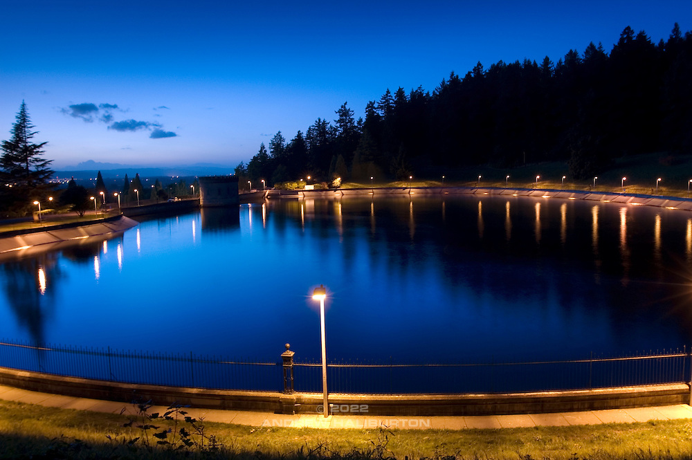 The Portland Water Bureau's open Reservoir 5 at dusk.  This is one of three open reservoirs at Mt Tabor Park and of five total in Portland.  The 3 open reservoirs in Mount Tabor Park were placed in the National Register of Historic Places on January 15, 2004.  Environmental Protection Agency (EPA) regulation: Long Term 2 Enhanced Surface Water Treatment Rule, referred to as the LT2 rule imposes new requirements that open water reservoirs be covered, buried or additionally treated.  This applies to Portland's five open reservoirs and to the unfiltered Bull Run sourse supplying them.