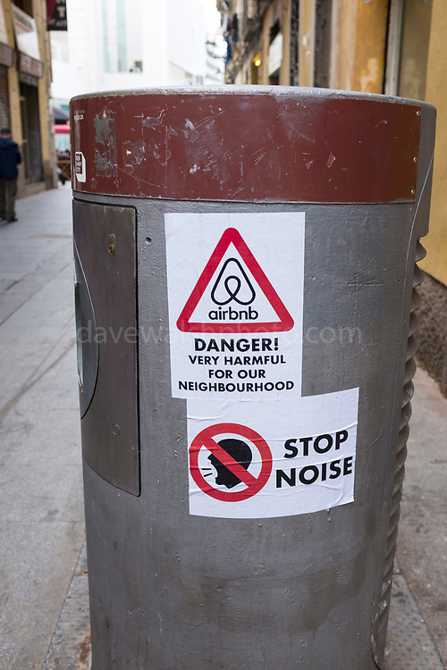Posters protesting property speculation and airbnb in The Raval, Barcelona, Spain