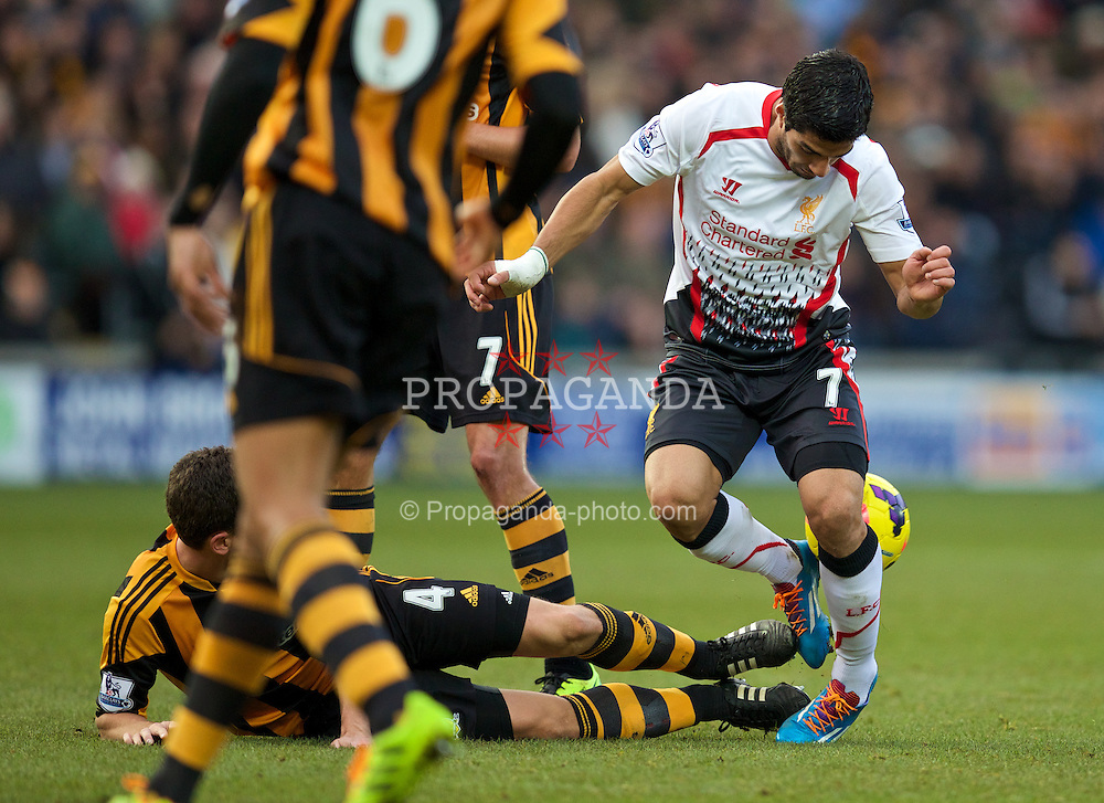 HULL, ENGLAND - Sunday, December 1, 2013: Liverpool's Luis Suarez in action against Hull City's Alex Bruce during the Premiership match at the KC Stadium. (Pic by David Rawcliffe/Propaganda)