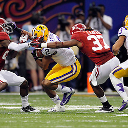 Jan 9, 2012; New Orleans, LA, USA; LSU Tigers wide receiver Rueben Randle (2) is tackled by Alabama Crimson Tide defensive back Dre Kirkpatrick (21) and defensive back Robert Lester (37) during the second half of the 2012 BCS National Championship game at the Mercedes-Benz Superdome.  Mandatory Credit: Derick E. Hingle-US PRESSWIRE